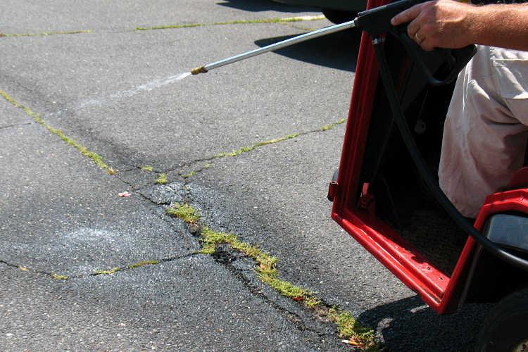 Spraying cracks in driveway