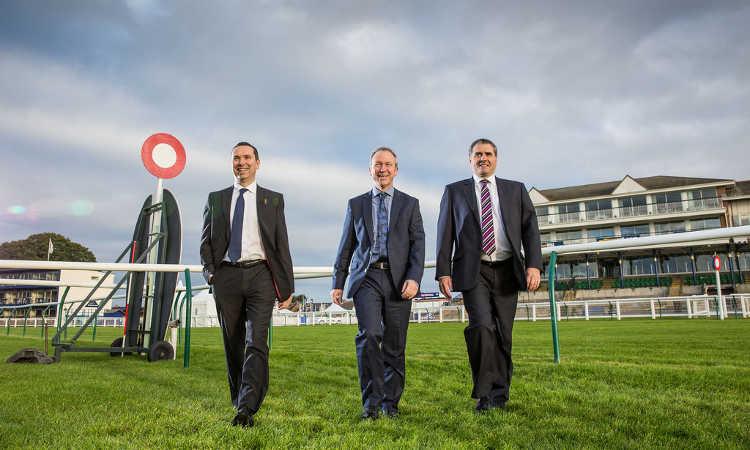 Business executives at racecourse