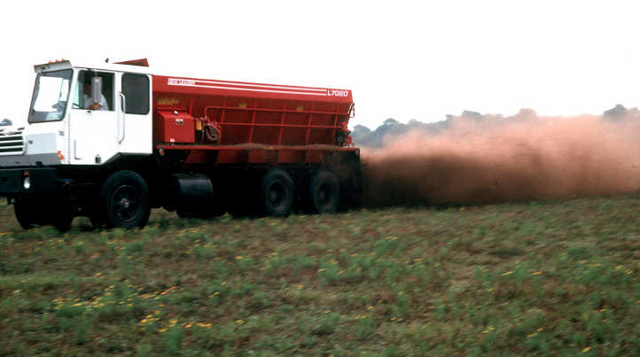 Spreading composted chicken manure