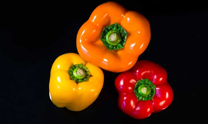 Three colors of ripe peppers
