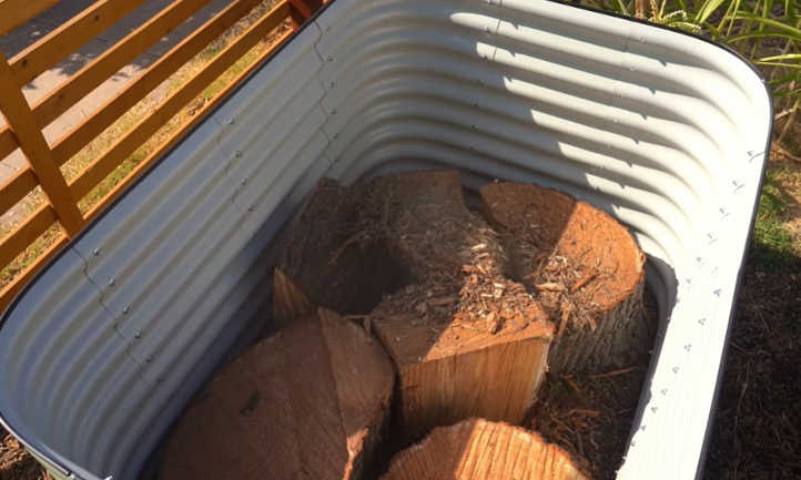 Adding logs into the raised bed